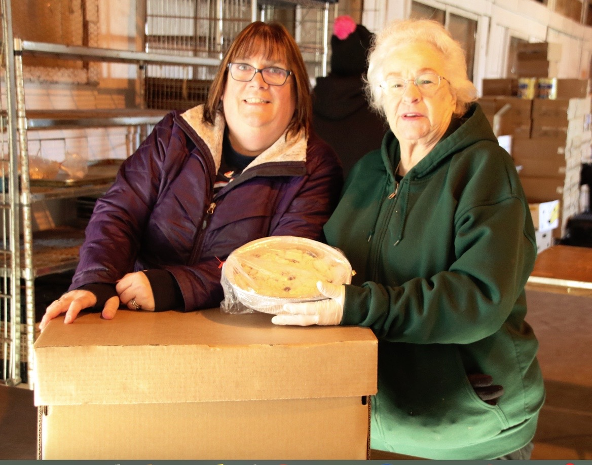 Lisa Campbell, left, and Yvette Cave were among the volunteers distributing Thanksgiving food boxes to needy folks on Tuesday at York County Shelter Programs on Shaker Hill in Alfred. Shelter officials said they expected to distribute 1,800 to 2,000 boxes of food for the holiday this year. TAMMY WELLS/Journal Tribune