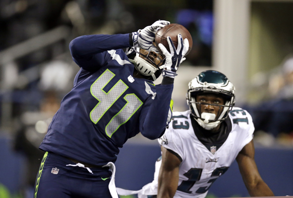 Seattle's Byron Maxwell intercepts a pass intended for Philadelphia's Nelson Agholor in the end zone during the second half Sunday night in Seattle.