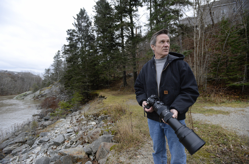 """Gerry Monteux, looking for eagles along the Union River in Ellsworth, traded in his microphone for a camera, and despite a tough transition would not change a thing. """"I lost my job. I lost my wife. I went through hell. But looking back it was the best thing that ever happened to me,"""" he said."""