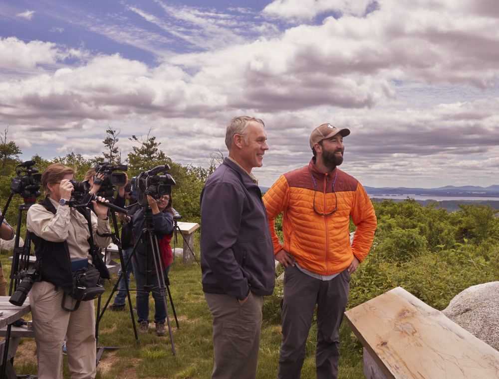 Interior Secretary Ryan Zinke, left, and Lucas St. Clair look out over the Katahdin Woods & Waters National Monument in June.
