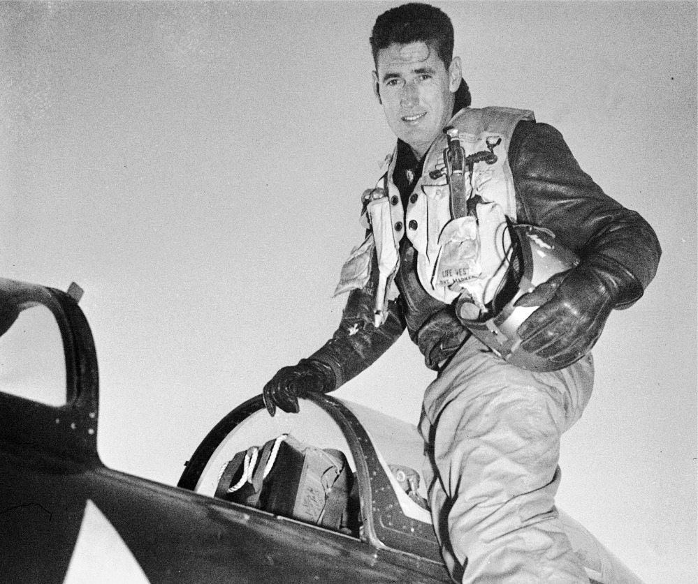 Capt. Ted Williams poses atop an airplane at a Marine air base in Korea after he crash landed his thunder jet at an advance airbase Feb. 15, 1953, on his first combat mission over North Korea against enemy targets.