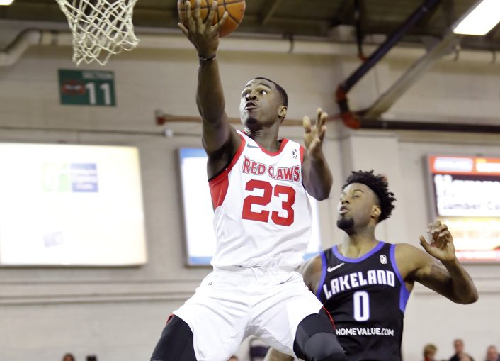 Maine's Jabari Bird takes a layup while being defended by Lakeland's Jamel Artis on Sunday at the Portland Expo. Bird scored 30 points and the Red Claws won 110-101.