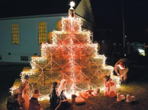 A SPECIAL LOBSTER TRAP CHRISTMAS TREE lit up at the Cundy's Harbor Community Church of the Nazarene.