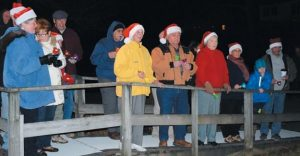 AT THE CUNDY'S HARBOR Community Church of the Nazarene, a bell choir plays Christmas carols for the crowd.