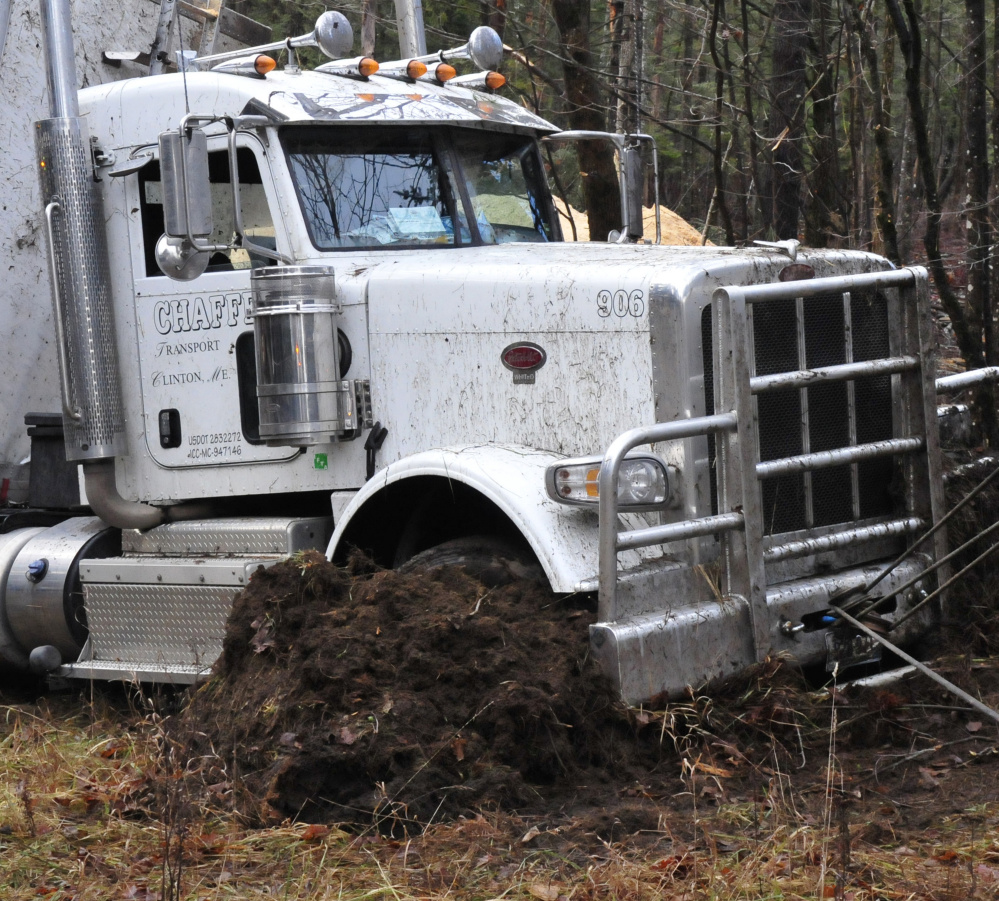 The front end of this tractor-trailer carrying sawdust dug into the ground after it overturned early Wednesday morning on Route 150 in Athens.