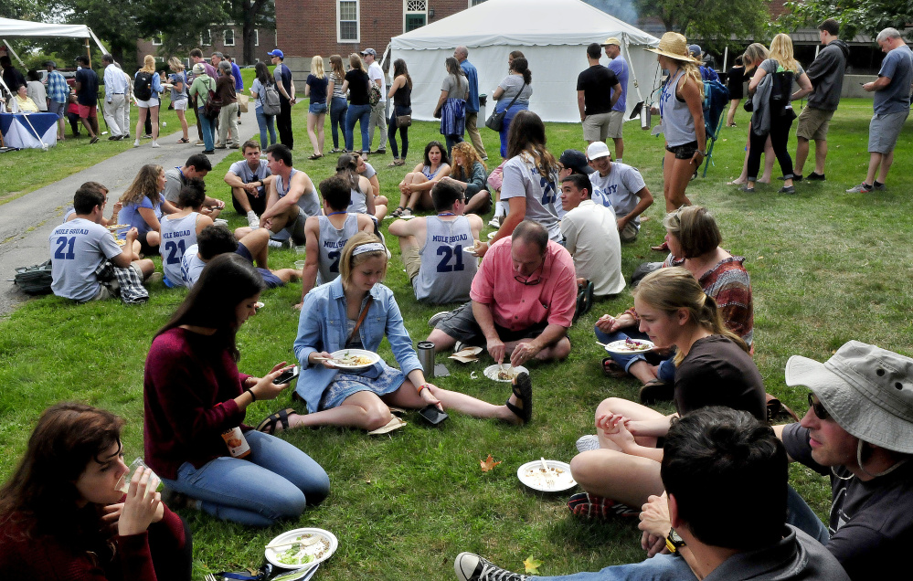 Colby College students and parents line up for lunch on the first day of freshmen arrivals on the Waterville campus on Aug. 29, 2017.