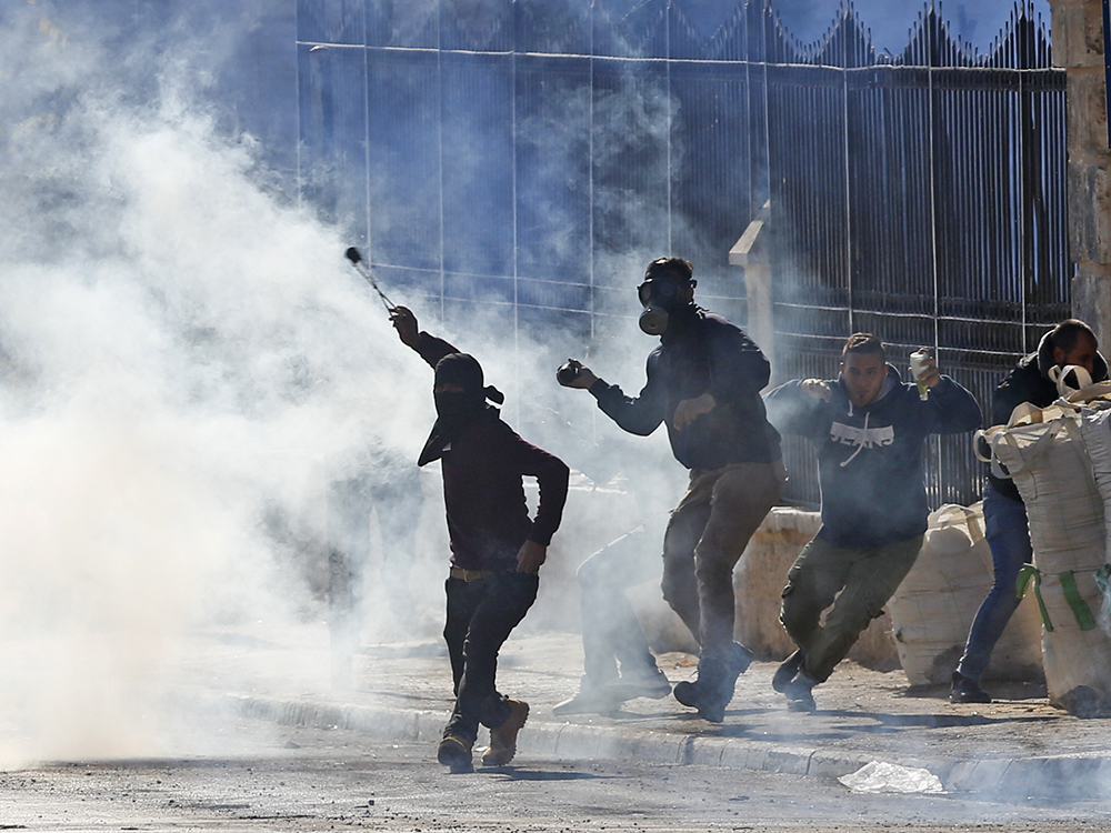 Palestinians clash with Israeli troops in the West Bank city of Bethlehem Friday.