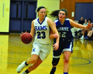 Kennebunk's Emily Archibald drives past a Morse defender on Friday night. Kennebunk picked up a 53-46 win. ALEX SPONSELLER/ Journal Tribune