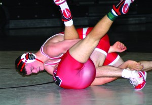Sanford's Sam Anderson works for a pin during a match last week against Wells.  Pat McDonald/Journal Tribune