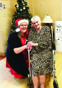 VNA Home Health Hospice patient Bev Patten, right, thanks  Amanda Carr of the Twilight Wish Foundation for making her dream of having a 'Christmas Tea' come true at St. Andre's Rehabilitation Center in Biddeford. COURTESY PHOTO/Jacqueline Welsh, VNA Home Health Hospice