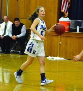 Kennebunk's Emily Hogue looks to pass in the first quarter on Friday night against Morse. ALEX SPONSELLER/ Journal Tribune