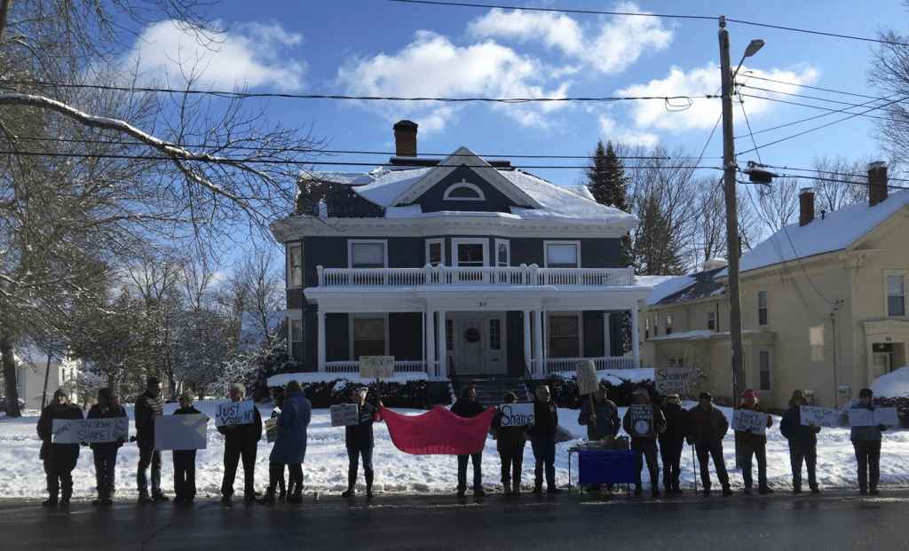 Protesters stand outside Sen. Susan Collins' home in Bangor on Sunday, the third such demonstration since Dec. 4. No one was arrested.