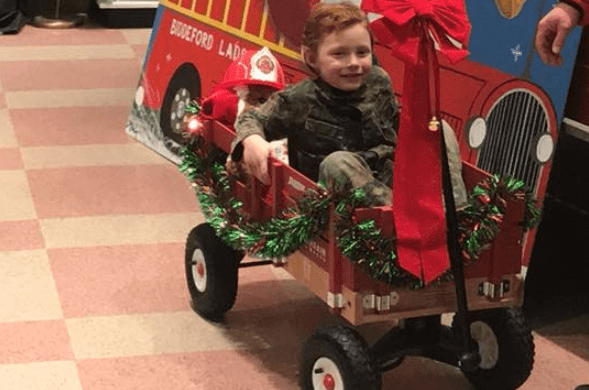**** checks out his new ride courtesy of the Biddeford Fire Department on Wednesday night.  Photo courtesy of Tim Sevigny
