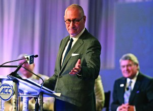 In this July 21, 2016 file photo, ESPN president John Skipper gestures as he talks about the new ACC/ESPN Network during a news conference at the Atlantic Coast Conference Football Kickoff in Charlotte, N.C. Skipper says he is resigning to take care of a substance abuse problem. The sports network says its former president, George Bodenheimer, will take over as acting head of the company for the next 90 days. AP NEWSWIRE