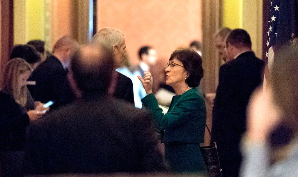 Sen. Susan Collins, R-Maine speaks with Sen. Rob Portman, R-Ohio, on Friday as Republican senators gathered to meet with Senate Majority Leader Mitch McConnell, R-Ky., on the effort to overhaul the tax code.