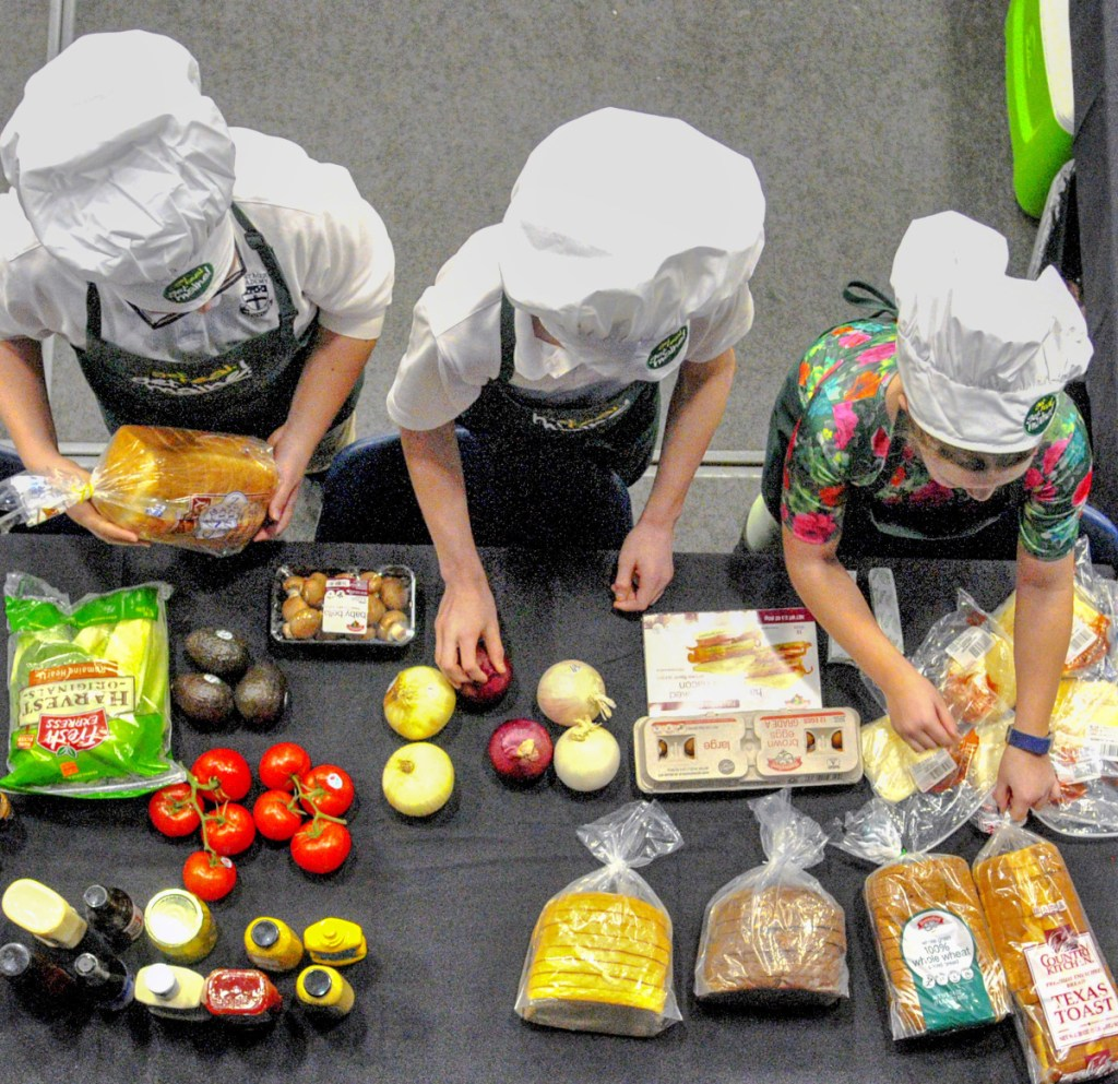 Contestants search the pantry at the start of a cooking contest during the 2018 Agricultural Trades Show in the Augusta Civic Center. Representatives of the U.S. Department of Agriculture won't be attending the Maine trade show next week because of the partial government shutdown.
