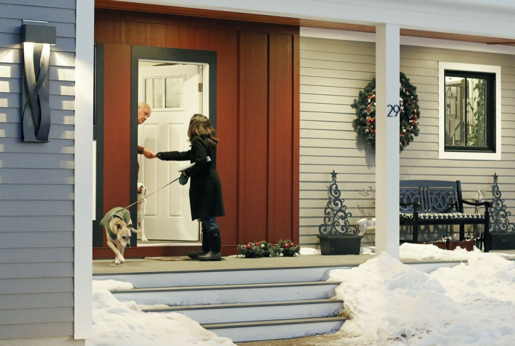 """Republican candidate Allyson Cavaretta of York shakes hands with a neighbor as she begins campaigning door-to-door on Osprey Lane, introducing herself and her run for state representative. """"I think, in general, women are feeling more empowered to run,"""" Cavaretta said."""