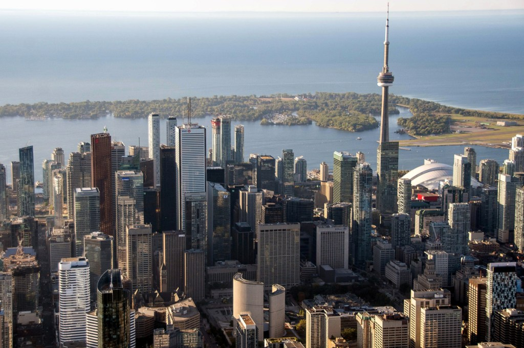 The CN Tower stands in the downtown Toronto skyline. Alphabet Inc., Google's parent company, will invest $50 million in a lakefront property that will house its Canadian headquarters.