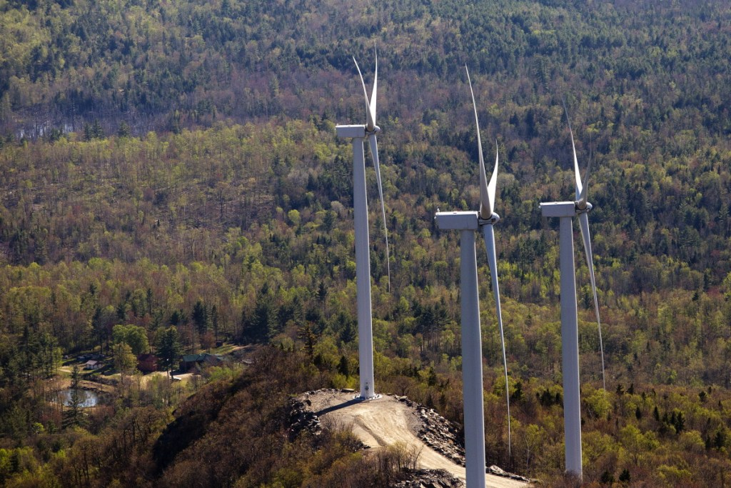 Three wind turbines owned by Patriot Renewables are seen along Saddleback Ridge in western Maine in 2015. Gov. Paul LePage has imposed a moratorium on wind energy permits for western and coastal Maine and created a panel to investigate wind farms' impact on tourism in the state.