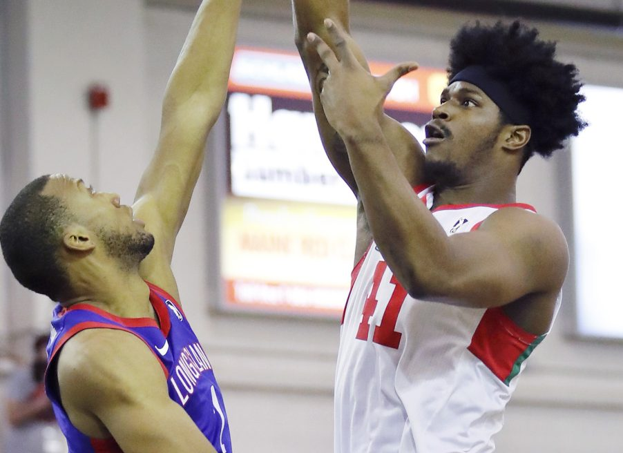 Devin Williams of the Maine Red Claws, taking a shot Sunday over Akil Mitchell of Long Island, has improved his offense to go with an unquestioned rebounding game and solid inside presence.