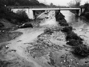 IN THIS PHOTO provided by Santa Barbara County Fire Department, U.S. Highway 101 at the Olive Mill Road overpass is flooded with runoff water from Montecito Creek in Montecito, California, on Tuesday. Dozens of homes were swept away or heavily damaged Tuesday as downpours sent mud and boulders roaring down hills stripped of vegetation by a gigantic wildfire that raged in Southern California last month.