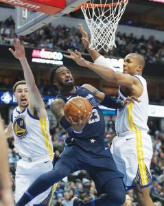 DALLAS MAVERICKS guard Wesley Matthews (23) tries to score against Golden State Warriors defenders Klay Thompson (11) and David West (3) during the second half of an NBA basketball game in Dallas on Wednesday. The Warriors won, 125-122.