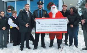MCDONALD'S AT COOK'S CORNER IN BRUNSWICK had its grand reopening in mid-December. Owners Steve and Taylor Goble of TMM, Inc. presented $500 checks to the Brunswick Police and Fire departments for their respective charities, while the Brunswick High School girls varsity basketball team helped with face painting, assisted Santa and mingled with guests. Also participating at the ribbon-cutting ceremony were Deb King, director of the Brunswick Downtown Association; David Watson, Brunswick town councilor; representatives of McDonald's corporate regional office, and local management staff. During this month and February, the restaurant will have Community Monday Nights, where 20 percent of sales between 5 and 7 p.m. will go to participating nonprofits, including The Teen Center, People Plus, Midcoast Hunger Prevention Program, Boy Scout Troop 633, BDA, Coastal Humane Society and American Legion Post 20.