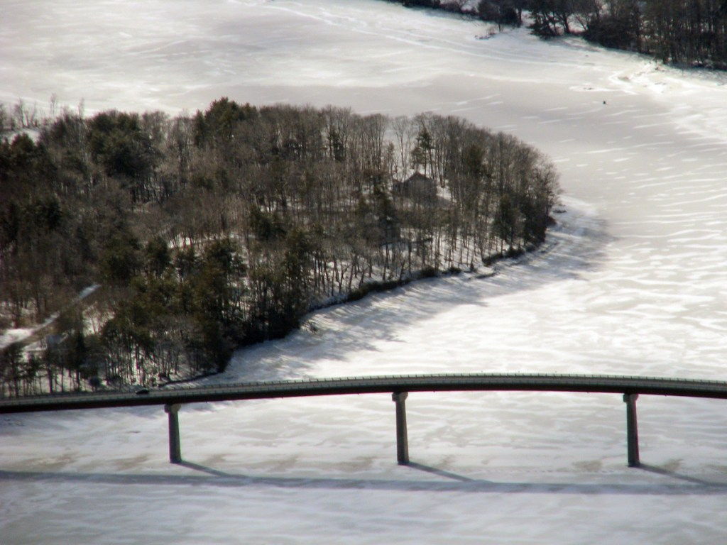 Solid ice around the Kennebec Maine Bridge is seen Wednesday in this image taken by the Coast Guard. The shore seen is  Dresden, at left, and Swan Island, at top.