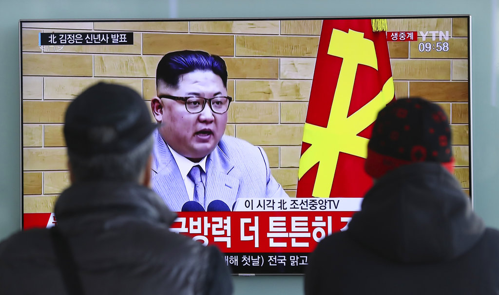 South Koreans watch North Korean leader Kim Jong Un's New Year's speech on a TV monitor at the Seoul Railway Station in Seoul, South Korea, Monday.