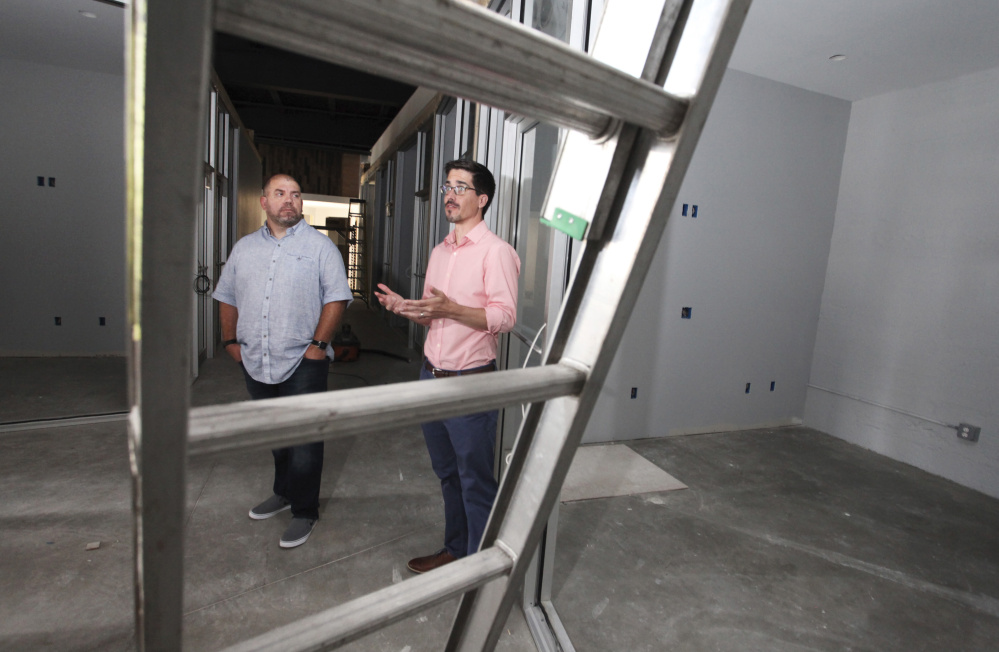 Jess Knox, left, founder of Maine Startup and Create Week, and partner Mike Sobol show off the space for Venture Hall in 2016 before it opened.