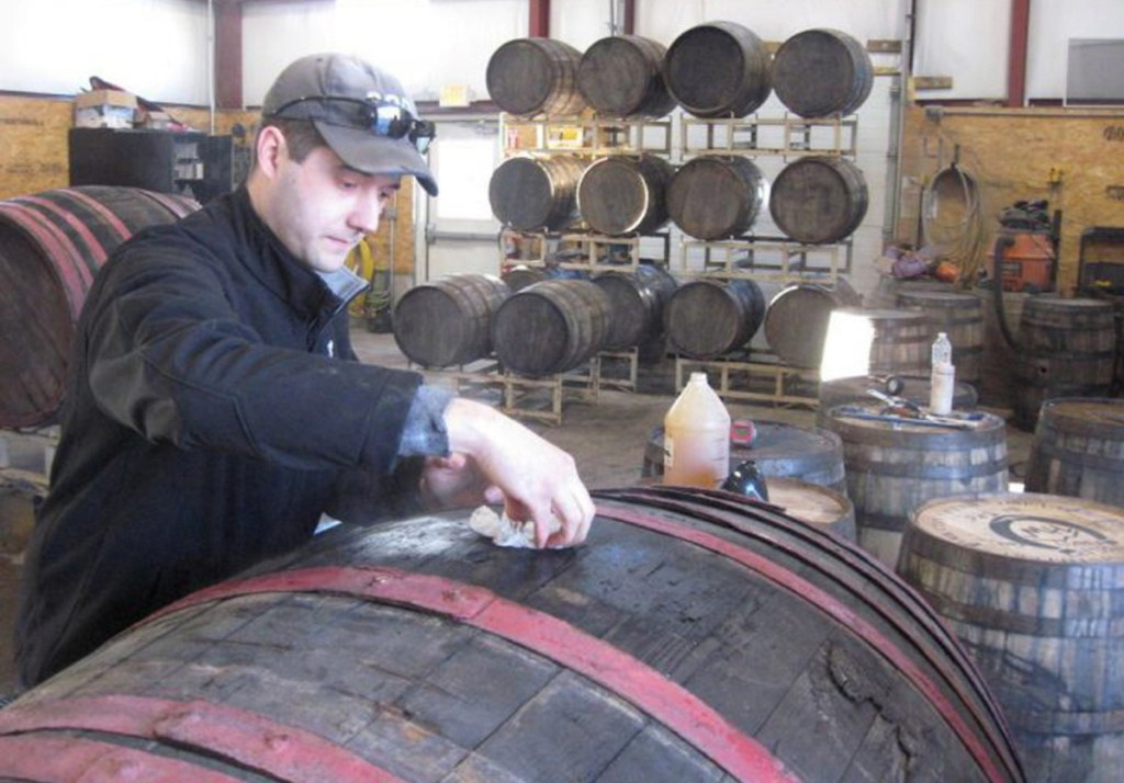 """Matt Albrecht, owner and founder of River Drive Cooperage-Millwork in Buxton, prepares a barrel he imported from Hungary for shipment to Michigan. """"Our goal is to push the limits on beer barrel aging,"""" he said."""