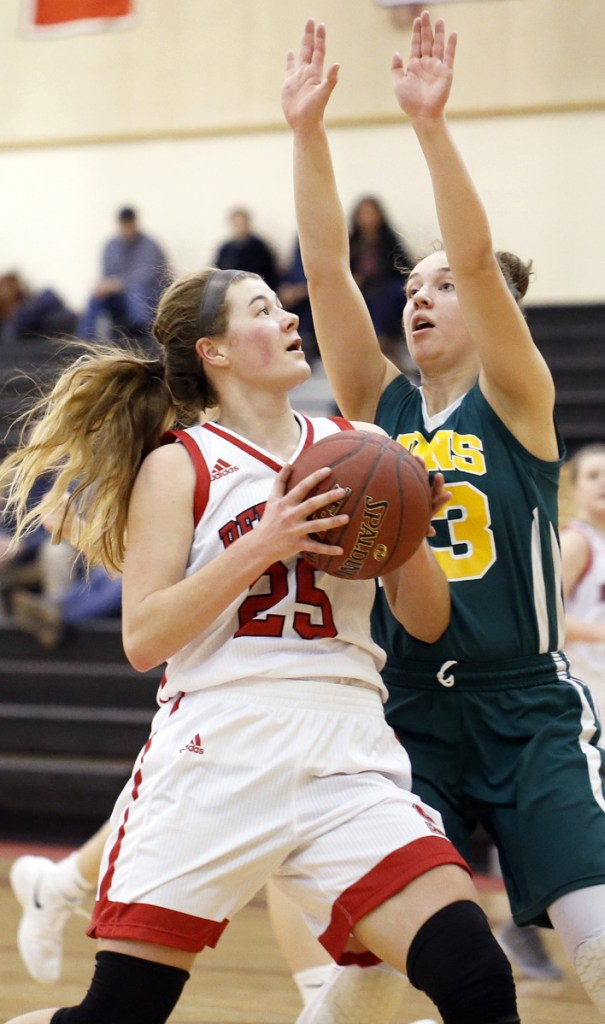 Sophie Glidden, who finished with 13 points, looks to shoot while defended by Serena Mower of Maine Girls' Academy.