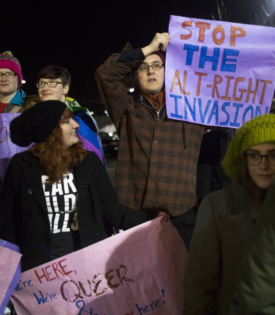 """Demonstrators protest last February outside a University of Southern Maine lecture hall during state Rep. Lawrence Lockman's talk, """"Alien Invasion: Fixing the Immigration Crisis."""" Campuses should welcome a wide range of speakers, UNE's president says."""