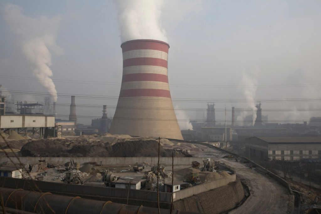 Smoke and steam rise in a part of the Jiujiang steel and rolling mills in northern China's Hebei province in a December 2016 photo. The Commerce Department wants the U.S. to impose tariffs or quotas on imported aluminum and steel.