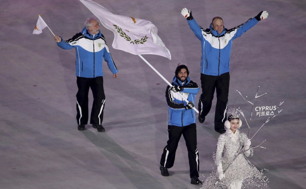 Joined by team officials, Dinos Lefkaritis carries the Cyprus flag in the Feb. 9 opening ceremony of the 2018 Winter Olympics in South Korea, where he is the island nation's only competitor.