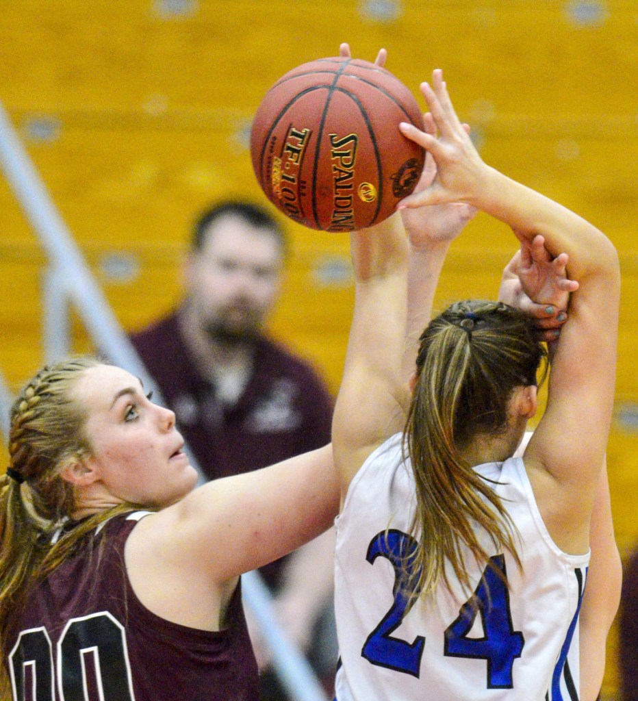 Richmond's Sydney Tilton, left, and Old Orchard Beach's Meghan LaPlante battle for a rebound. Tilton had nine points and 10 rebounds in the Bobcats' 33-30 win.