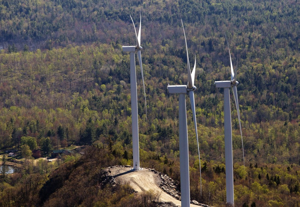 Wind turbines in Dixfield atop a ridge south of Webb Lake. Gov. LePage's moratorium order is being challenged.