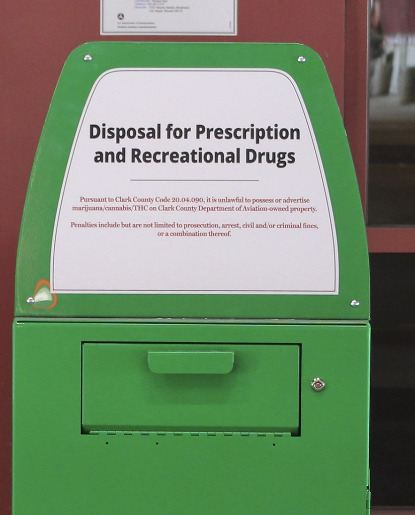 """A metal container is designed for """"Disposal for Prescription and Recreational Drugs."""""""
