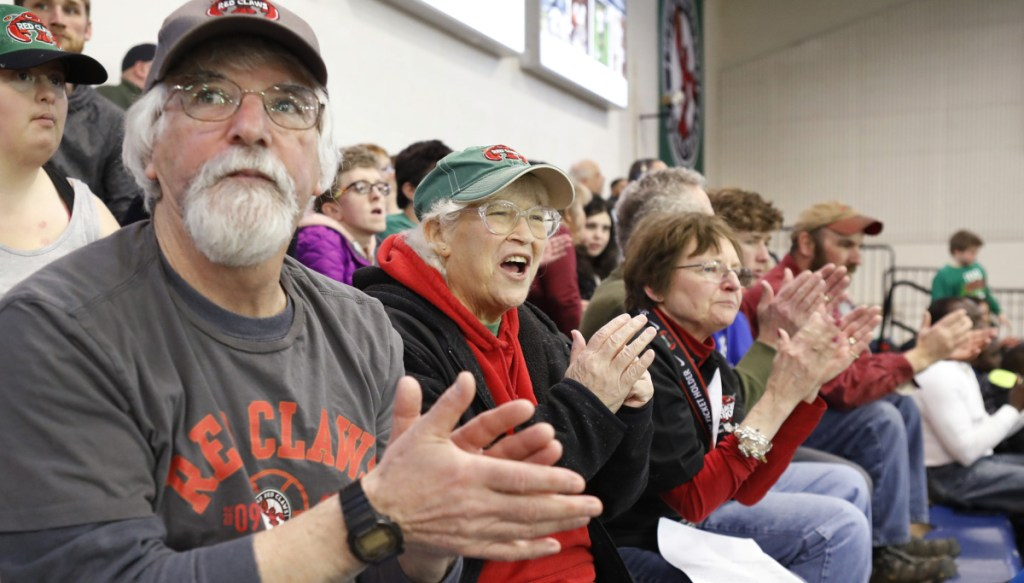 Stephen Lerman, Cindy Lerman and Pam Barker, left to right, don't just cheer for the Maine Red Claws, but do eveything they can to make sure the players feel at home during their time in Portland.