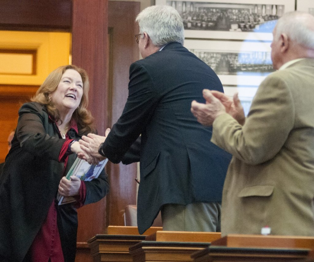 Maine Chief Justice Leigh Saufley greets Rep. Robert Foley, R-Wells, as she enters the House chamber to give her annual address Tuesday in Augusta. She said the pilot program would include addiction treatment, mental health services, job training, sober housing and other services.