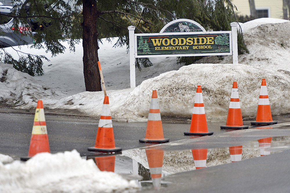 Cones block the entrance to Woodside Elementary School in Topsham after its evacuation Friday morning.