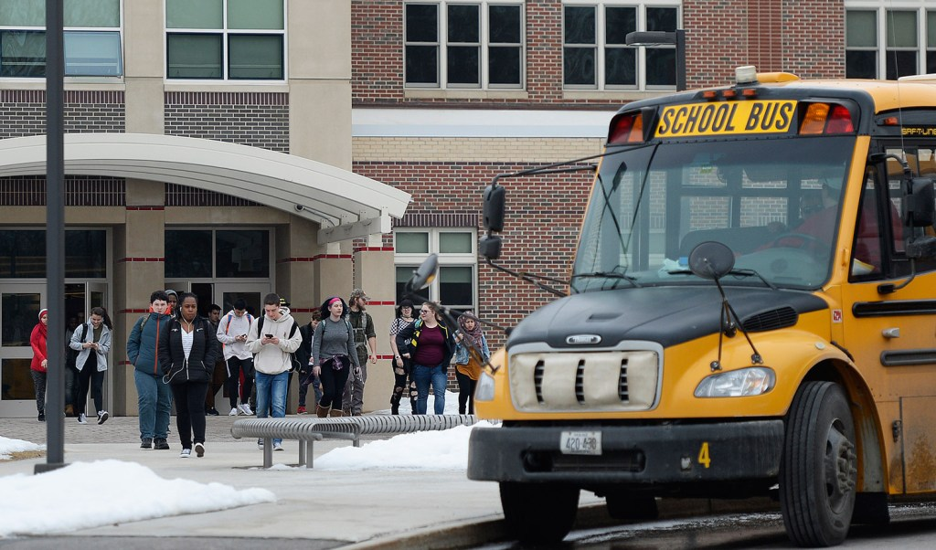 """Students leave South Portland High School at the end of the school day Thursday. A student was arrested in the morning on a charge of terrorizing after allegedly posting a social media message about """"shooting up the school."""""""
