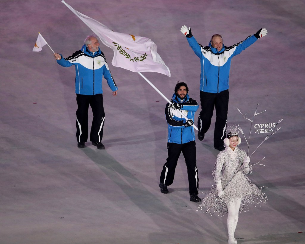 Dinos Lefkaritis carries the flag of Cyprus during the opening ceremony of the 2018 Winter Olympics in Pyeongchang, South Korea, on Friday.
