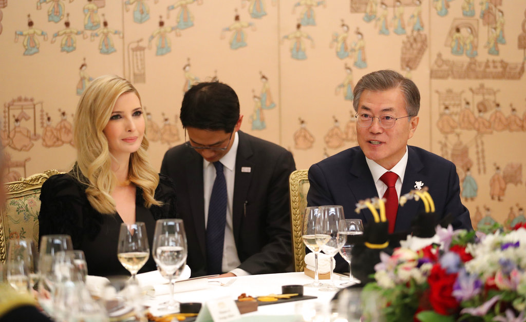 Ivanka Trump and South Korean President Moon Jae-in, right, have dinner at the presidential Blue House in Seoul on Friday. Trump is flanked by  Moon's aides who sat with heads bowed in gestures of respect.