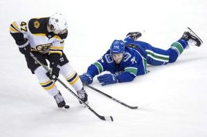 Nikolay Goldobin of the Vancouver Canucks dives to prevent Torey King of the Boston Bruins from getting to the puck during the third period of an NHL game in Vancouver, British Columbia on Saturday, Feb. 17, 2018. AP NEWSWIRE