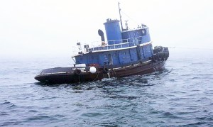 The 80-foot tugboat Capt Mackintire is shown in tow off the coast of Portland. It later sank about 3 miles south of Kennebunk in about 158 feet of water. The Coast Guard is working with federal, state, and local authorities to evaluate pollution potential and respond to reports of sheening in the area. COURTESY PHOTO/U.S. Coast Guard