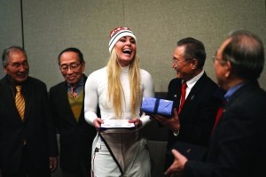 United States' Lindsey Vonn, center, smiles as she receives gifts and a letter of appreciation for her grandfather's service during the Korean War from members of the Yongsan Club in Jeongseon, South Korea, Thursday. AP NEWSWIRE