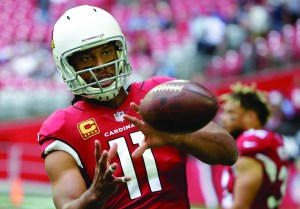 In this Dec. 10, 2017, file photo, Arizona Cardinals wide receiver Larry Fitzgerald warms up prior to an NFL football game against the Tennessee Titans in Glendale, Ariz. AP NEWSWIRE