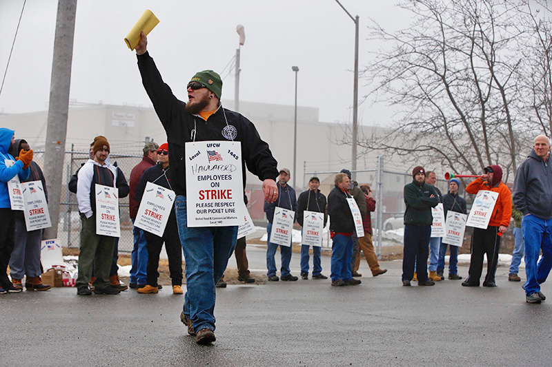 Mathew Farrell, an 18-year employee and shop steward, pickets outside the Hannaford distribution center in South Portland during a one-day strike on Feb. 21.