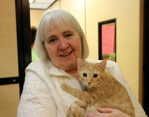 Linda Freeman of Saco has a new love in her life — a little orange kitten she adopted Saturday at the 'Speed Date' event put on over the weekend at PetSmart in Biddeford and sponsored by the store and the Animal Welfare Society of West Kennebunk. TAMMY WELLS/Journal Tribune